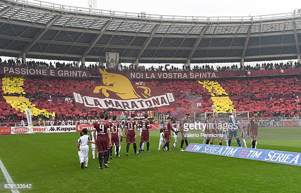 Fans of FC Torino show a giant banner during the Serie A match between FC Torino and Juventus FC at Stadio Olimpico di Torino on December 11 2016 in...