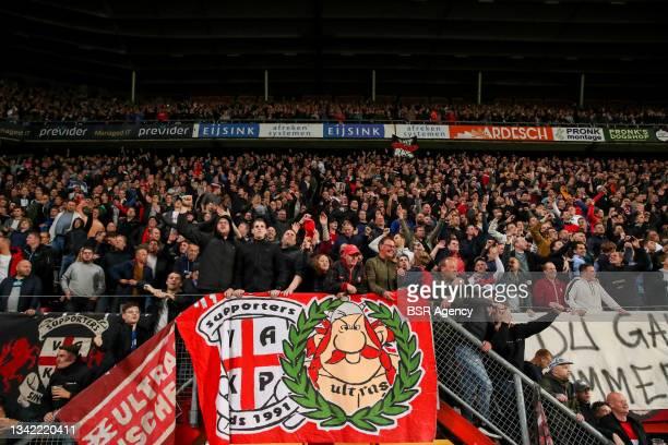 Fans of FC Twente during the Dutch Eredivisie match between FC Twente and AZ at De Grolsch Veste on September 23, 2021 in Enschede, Netherlands