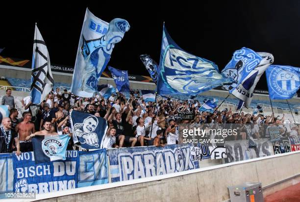 Fans of FC Zurich cheer for their team ahead of their Europa League Group A match against AEK Larnaca at the GSP stadium in the Cypriot capital...