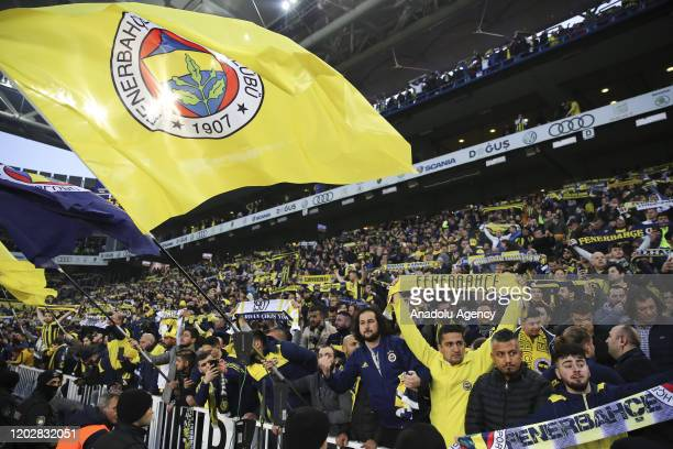 Fans of Fenerbahce support their team during the Turkish Super Lig derby match between Fenerbahce and Galatasaray in Istanbul, Turkey on February 23,...