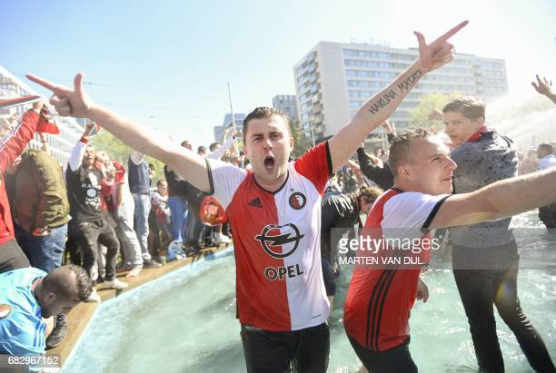 Fans of Feyenoord cheer after their club won the champions trophy during the Dutch Eredivisie match between Feyenoord Rotterdam and Heracles Almelo...