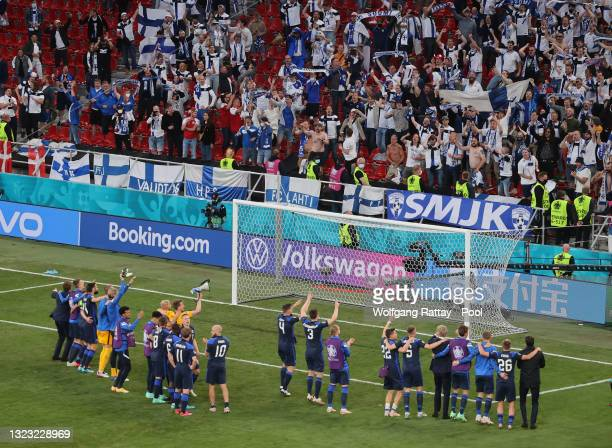 Fans of Finland celebrates their side's victory after the UEFA Euro 2020 Championship Group B match between Denmark and Finland on June 12, 2021 in...