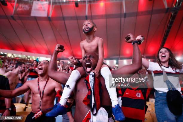 Fans of Flamengo celebrate their team's win after the Flamengo v River Plate Copa CONMEBOL Libertadores 2019 Final at Maracana Stadium on November 23...