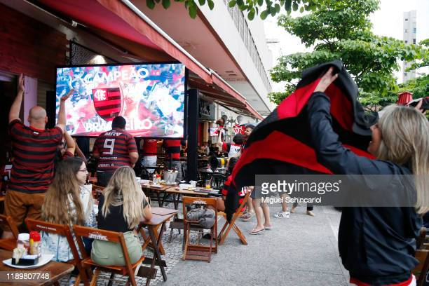 Fans of Flamengo celebrate their team's win the Copa do Brasil after Gremio defeated Palmeiras the day after Flamengo won the Copa CONMEBOL...