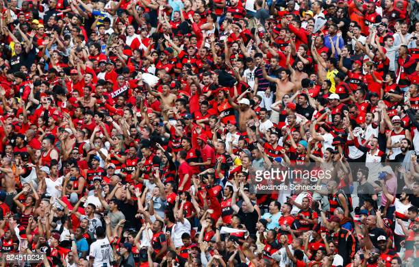 Fans of Flamengo cheer during the match between Corinthians and Flamengo for the Brasileirao Series A 2017 at Arena Corinthians Stadium on July 30...