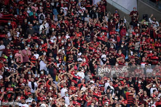 Fans of Flamengo cheer their team during a semi final first leg match between Flamengo and Barcelona SC as part of Copa CONMEBOL Libertadores 2021 at...