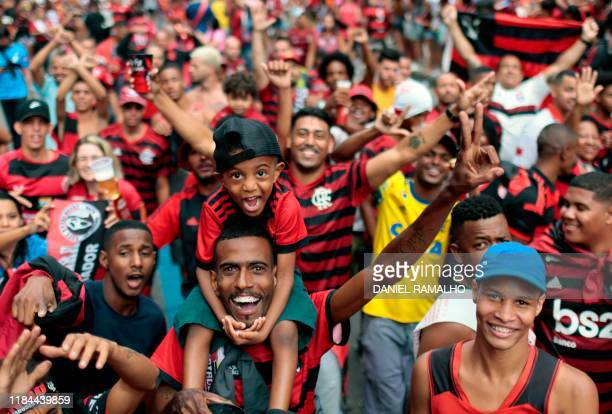 TOPSHOT Fans of Flamengo football club take part in a celebration parade following the team's arrival after their Libertadores final match victory...