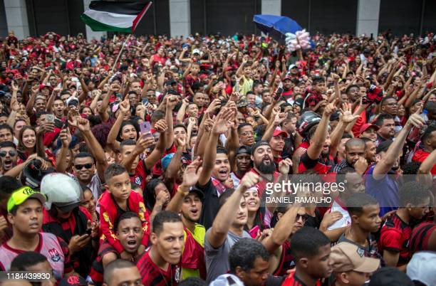 Fans of Flamengo football club take part in a celebration parade following the team's arrival after their Libertadores final match victory over...