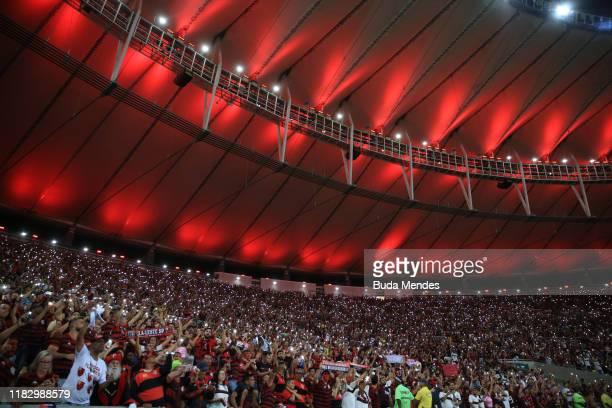 Fans of Flamengo hold up their phones prior to a second leg semifinal match between Flamengo and Gremio as part of Copa CONMEBOL Libertadores at...