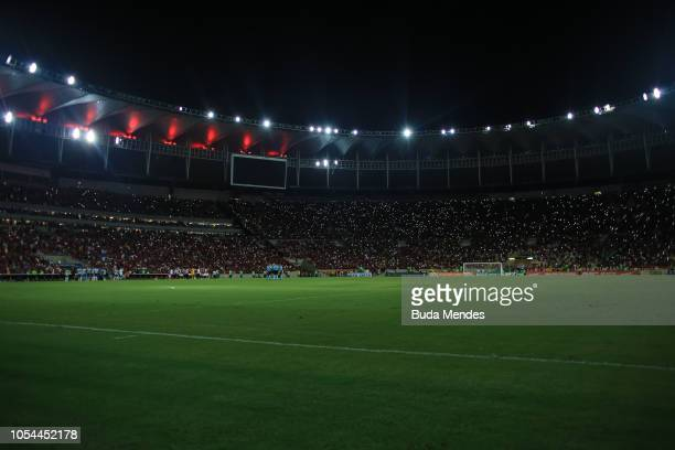 Fans of Flamengo use their phones during a blackout in the match between Flamengo and Palmeiras as part of Brasileirao Series A 2018 at Maracana...