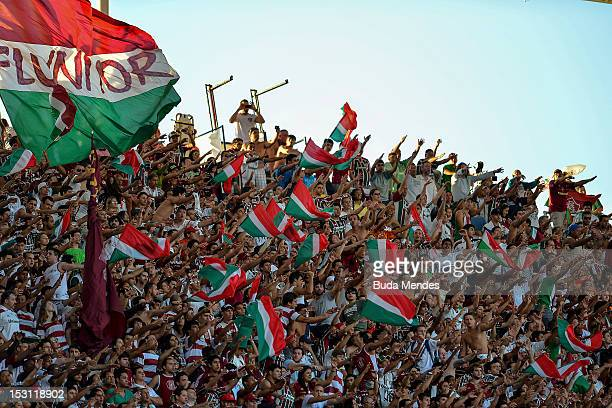Fans of Fluminense celebrate a goal during a match as part of Serie A 2012 at Engenhao stadium on September 30 2012 in Rio de Janeiro Brazil