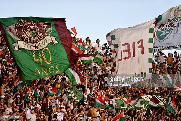 Fans of Fluminense celebrate a victory against Flamengo during a match as part of Serie A 2012 at Engenhao stadium on September 30 2012 in Rio de...