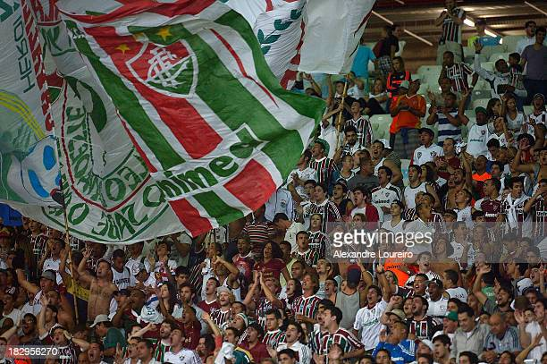 Fans of Fluminense cheer during the match between Fluminense and Botafogo for the Brazilian Series A 2013 at Maracana on October 2 2013 in Rio de...