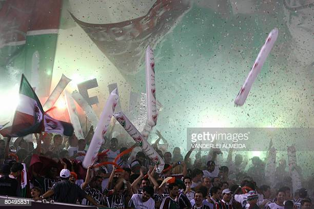 Fans of Fluminense FC of Brazil celebrate their team's first goal during the Libertadores Cup match against Paraguay's Libertad CF at Maracana...