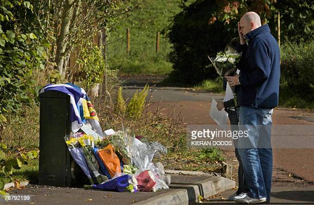Fans of former world rally champion Colin McRae prepare to place flowers in his memory at the entrance to his home in Lanark in Scotland 17 September...