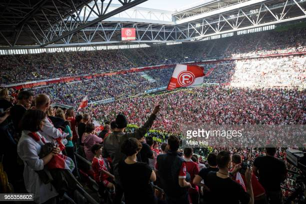 Fans of Fortuna Duesseldorf celebrate their first league advancement after the Second Bundesliga match between Fortuna Duesseldorf and Holstein Kiel...