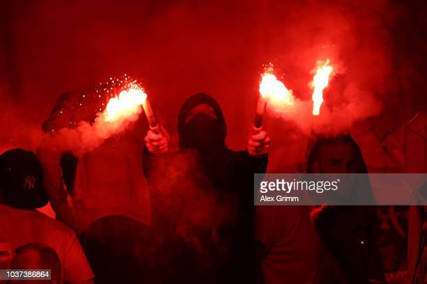 Fans of Fortuna Duesseldorf holds flares during the Bundesliga match between VfB Stuttgart and Fortuna Duesseldorf at MercedesBenz Arena on September...