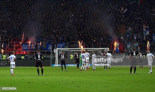 Fans of Frankfurt burn Darmstadt banners during the Bundesliga match between Eintracht Frankfurt and SV Darmstadt 98 at CommerzbankArena on December...