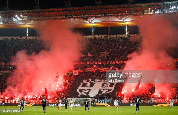 Fans of Frankfurt burn flares during the UEFA Europa League Group H match between Eintracht Frankfurt and SS Lazio at CommerzbankArena on October 4...