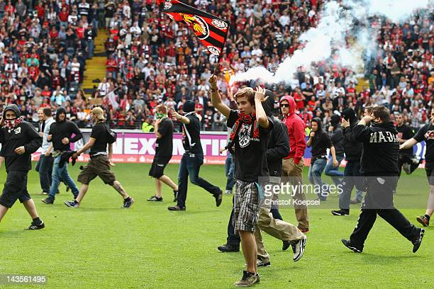 Fans of Frankfurt make a runs with the ballon the pitch after the ascent to the 1 Bundesliga aft the Second Bundesliga match between Eintracht...