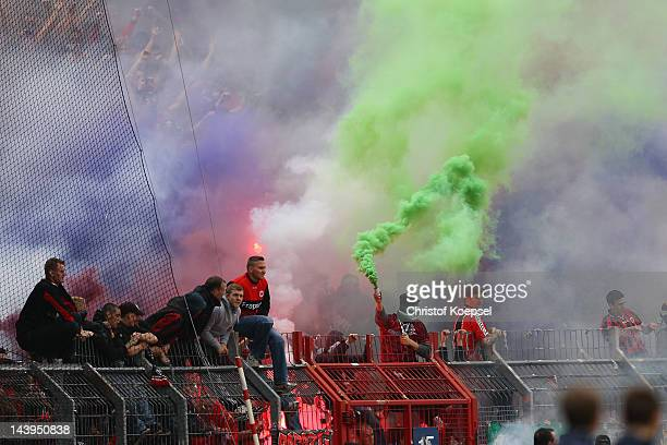 Fans of Frankfurt throw smokebombs during the Second Bundesliga match between Karlsruher SC and Eintracht Frankfurt at Wildpark stadium on May 6 2012...