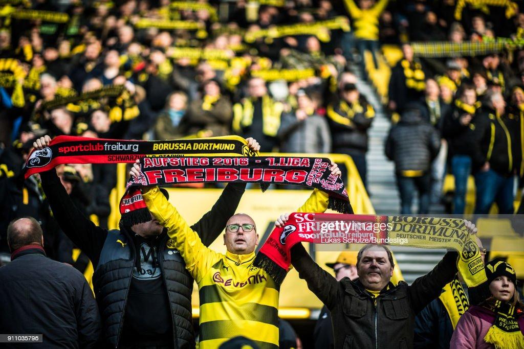 Fans of Freiburg and Dortmund raise their scarves prior to the Bundesliga match between Borussia Dortmund and Sport-Club Freiburg at Signal Iduna Park on January 27, 2018 in Dortmund, Germany.