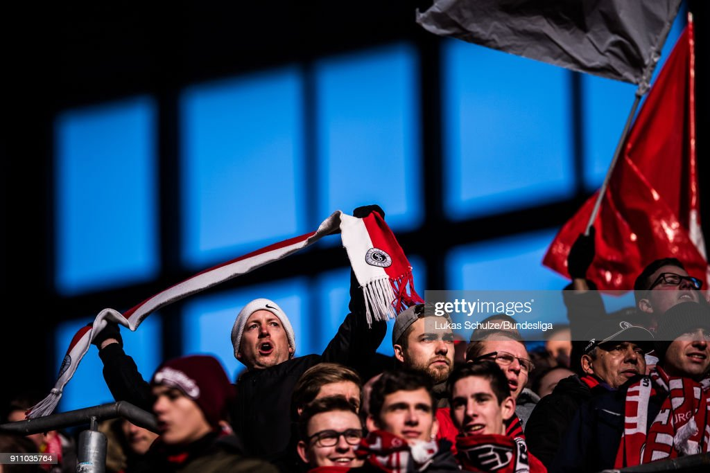 Fans of Freiburg support their team during the Bundesliga match between Borussia Dortmund and Sport-Club Freiburg at Signal Iduna Park on January 27, 2018 in Dortmund, Germany.