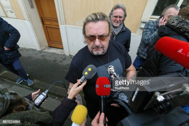 Fans of French singer and actor Johnny Hallyday and journalists gather near the house of Johnny Hallyday in MarneslaCoquette on December 6 2017...