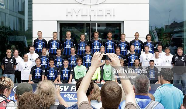 Fans of FSV Frankfurt disturb the official teamphoto by using their cellphones while Dennis Hillebrand Markus Husterer Stefan Hickl Fikri El Haj Ali...