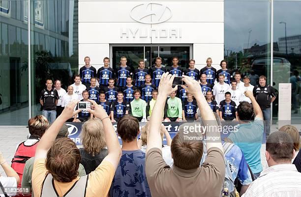 Fans of FSV Frankfurt disturb the official teamphoto by using their cellphones while Dennis Hillebrand Markus Husterer Stefan Hickl Fikri El Haj Ali...