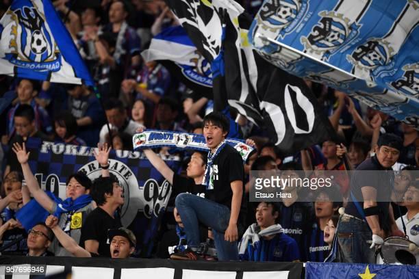Fans of Gamba Osaka cheer during the JLeague J1 match between Yokohama FMarinos and Gamba Osaka at Nissan Stadium on May 12 2018 in Yokohama Kanagawa...