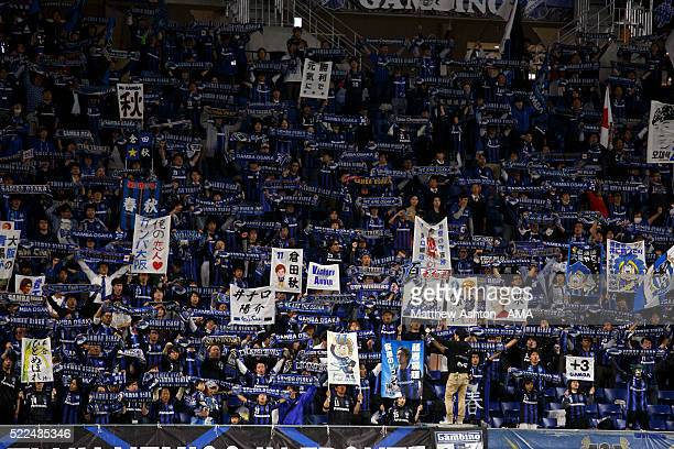 Fans of Gamba Osaka hold up scarfs and banners during the AFC Champions League Group G match between Gamba Osaka and Suwon Samsung Bluewings at Suita...