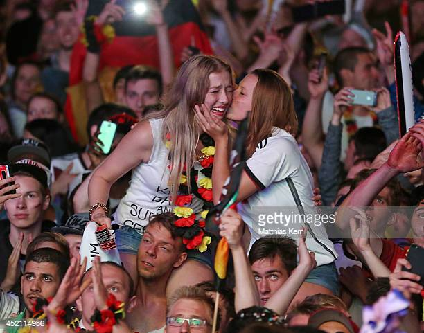 Fans of Germany celebrate after their team winning the 2014 FIFA World Cup final match between Germany and Argentina at the Fanmeile public viewing...