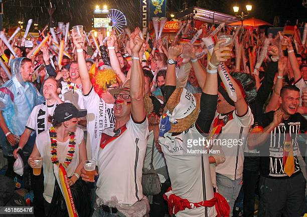 Fans of Germany celebrate during the 2014 FIFA World Cup Brazil semi final match between Brazil and Germany at the Fanmeile public viewing at...