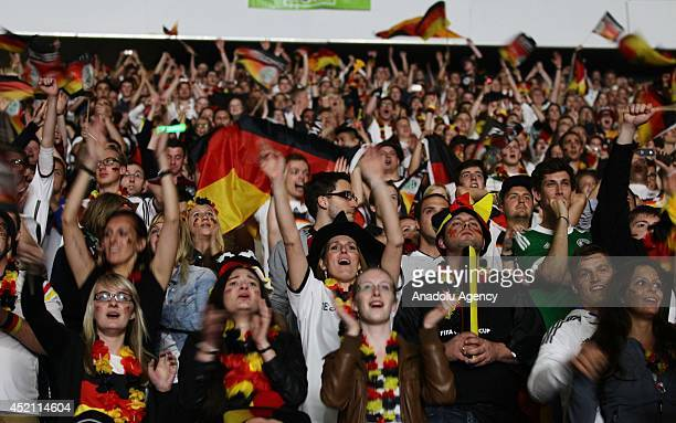 Fans of Germany celebrate their team's victory during a live broadcast of World Cup final soccer match between Germany and Argentina at the...