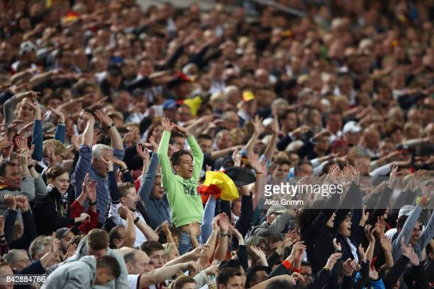 Fans of Germany do the Mexican wave La Ola during the FIFA World Cup Russia 2018 Group C Qualifier between Germany and Norway at MercedesBenz Arena...