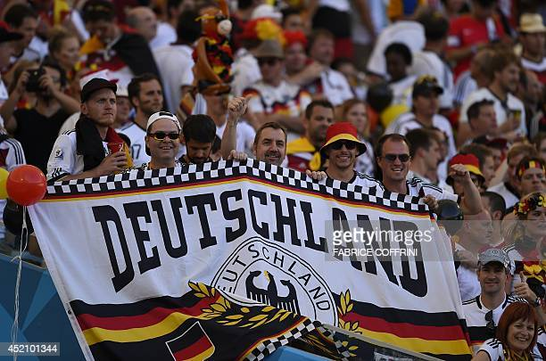 Fans of Germany hold up a banner reading 'Deutschland' before the 2014 FIFA World Cup final football match between Germany and Argentina at the...