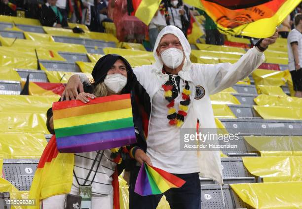 Fans of Germany hold up rainbow flags prior to the UEFA Euro 2020 Championship Group F match between Germany and Hungary at Allianz Arena on June 23,...