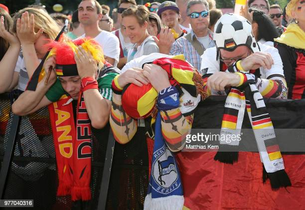 Fans of Germany watch the 2018 FIFA World Cup match between Germany and Mexico at the Fanmeile public viewing at Brandenburg Gate on June 17 2018 in...