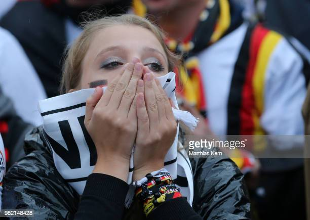 German fans as they watch the Germany national team play in their 2018 FIFA World Cup Russia match against Sweden at 11 Freunde Die Fussball Arena on...