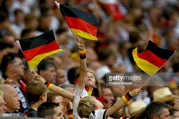 Fans of Germany wave flags during the International Friendly match between Germany and Hungary at VeltinsArena on June 4 2016 in Gelsenkirchen Germany