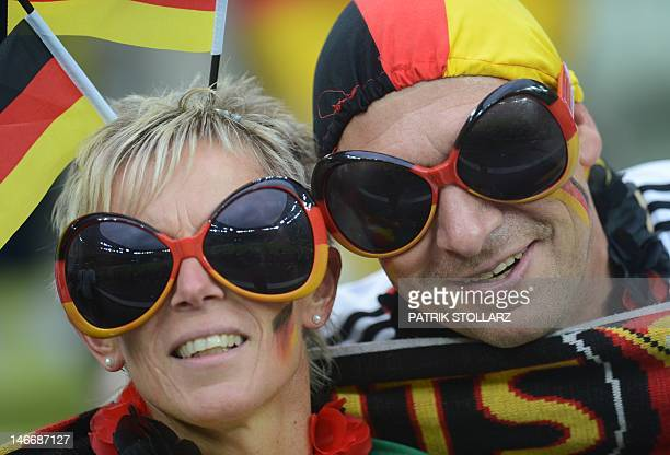 Fans of Germany's national football team pose with sunglasses ahead of the Euro 2012 football championships quarterfinal match Germany vs Greece on...