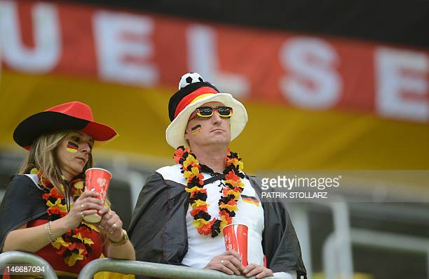 Fans of Germany's national football teams wait ahead of the Euro 2012 football championships quarterfinal match Germany vs Greece on June 22 2012 at...