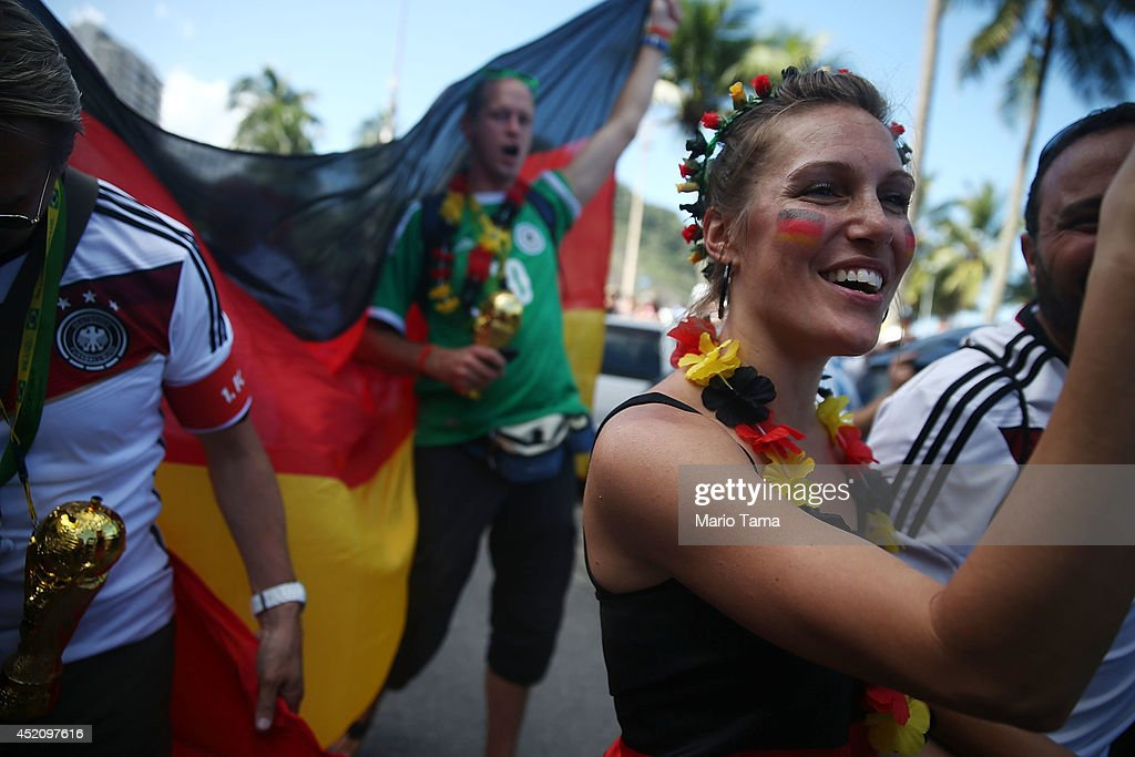 Fans of Germany's national team march along Copacabana Beach ahead of the 2014 FIFA World Cup final match against Argentina on July 13, 2014 in Rio de Janeiro, Brazil. The match will be held at the famed Maracana stadium.