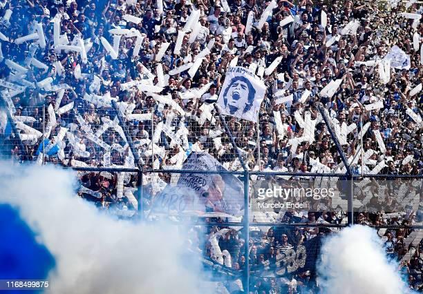 Fans of Gimnasia y Esgrima La Plata cheer for their team before a match between Gimnasia y Esgrima La Plata and Racing Club as part of Superliga...