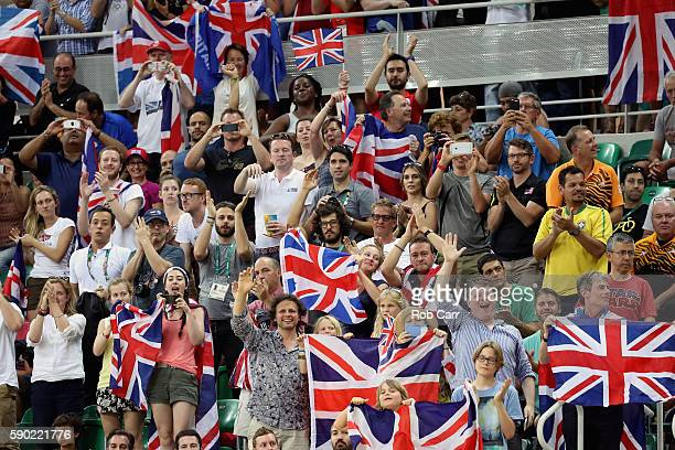Fans of Great Britain cheer as gold medalist Laura Trott of Great Britain celebrates during the medal ceremony after the women's Omnium Points race...