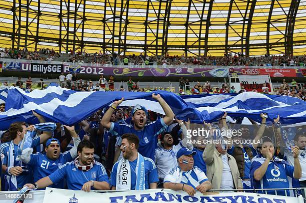 Fans of Greece's national football team react ahead of the Euro 2012 football championships quarterfinal match Germany vs Greece on June 22 2012 at...