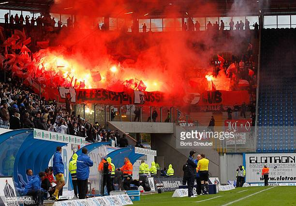 Fans of Halle burn flares during the Third League match between Hansa Rostock and Hallescher FC at DKBArena on September 22 2012 in Rostock Germany