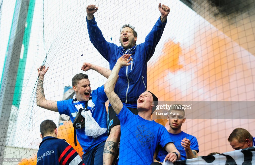 Fans of Hamburg celebrate after the Bundesliga Playoff Second Leg match between SpVgg Greuther Fuerth and Hamburger SV at Trolli-Arena on May 18, 2014 in Fuerth, Germany.