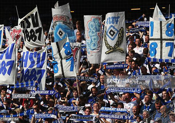 Fans of Hamburg celebrate prior to the Bundesliga match between Hamburger SV and 1 FC Nuernberg at Imtech Arena on August 25 2012 in Hamburg Germany